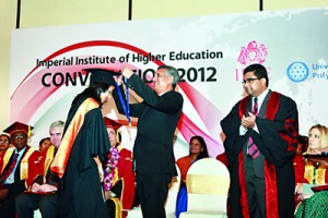 BSc student April Heenatigalle receiving the Gold Medal for best academic performance year 2012