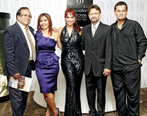 Afterglow: Danielle (centre) with her parents Beverly and Chris, and the men who made it happen - Mano Chanmugam (left) and Neomal de Alwis (right)