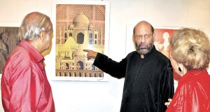 An exhibition by internationally acclaimed Pakistani artist Jimmy Engineer is on at the Harrold Pieris Gallery  from 9 a.m. to 8 p.m. until November 22. Here the artist is seen explaining one of his paintings to an art lover. (Please see Plus Page 4 for an interview with the artist).