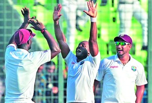 West Indies cricketer Tino Best (L) and teammate Veerasammy Permaul celebrate after winning the first cricket Test match between Bangladesh in Dhaka. - AFP