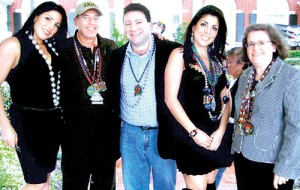 Rubbing shoulders: Jill Kelley (second right) and her twin sister Natalie (left) are pictured with David Petraeus, his wife Holly and Kelley's husband Scott (centre) at a party at their Tampa home