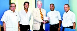 MCC Member Tom Seabrook presents Kushil Gunasekera with his invitation to HLM of MCC