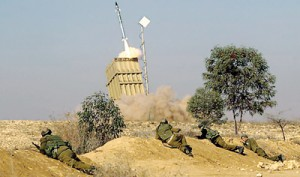 Operation: Israeli soldiers take cover as the 'Iron Dome' fires a missile (Daily Mail)