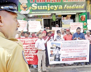 Scores of people held a demonstrations at the Jaffna bus stand yesterday to protest against the Kudankulam nuclear plant in Tamil Nadu. Pic by T. Premnath
