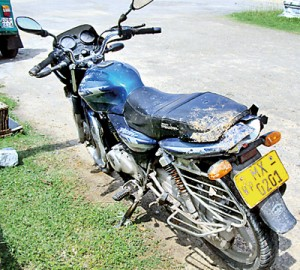 The motorcycle on which the ill-fated  father of four travelled on that fateful day and below his shoe on the riverbed.