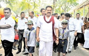 President Rajapaksa being received by the organisers of the healthy food exhibition at the Viharamahadevi Park yesterday. Pic by Gayan Amerasekera