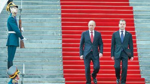 Russia has brought in a new treason law which opponents say Putin (pictured left) will use it to silence his critics