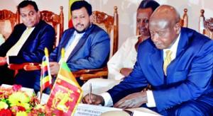 President of Uganda signs MoU document. Pic by Hasitha Kulasekera