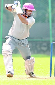 Sampath Bank's Thilina Kandamby who scored a belligerent 77 in action.