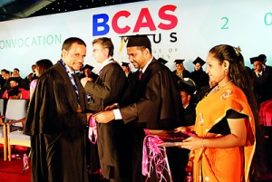 Student Receiving the award from Chairman BCAS Campus