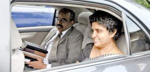 Chief Justice Shirani Bandaranayake pulled down the rear window to give a broad smile to journalists when she drove to Parliament on Friday for the hearing of the impeachment motion against her. Pic by Indika Handuwala