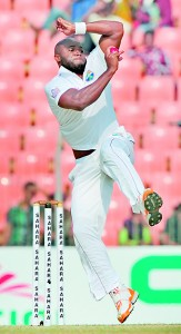 Tino Best delivers a ball during the fourth day of the second cricket Test match between Bangladesh and The West Indies at The Sheikh Abu Naser Stadium in Khulna on November 24, 2012
