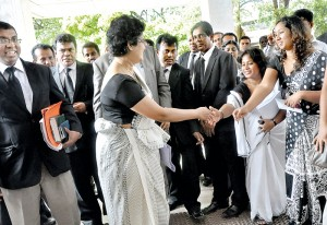 'Don't give up, keep it up' seems to be message from lawyers and the Supreme Court staff as Chief Justice Shirani Bandaranayake returned to her chambers in Hulftsdorp after she confidently faced an impeachment motion against her before the Parliamentary Select Committee on Friday.  Pic by Mangala Weerasekera