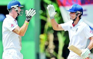 Kevin Pietersen and Alastair Cook put on an unbeaten 110 run stand to take England to a challenging 178 for 2 in replay to India's 327.