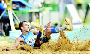 Over-20 Triple Jump winner D.M.E. Dinesha of Gampaha set a new meet record. - Pics by Amila Gamage.