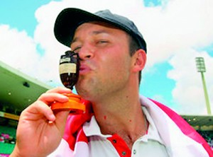 England cricketer Jonathan Trott kisses the Ashes