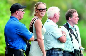 Tennis champion and golfer Rory McIlroy's girlfriend, Caroline Wozniacki (2nd L), of Denmark attends the second round of the DP World Tour Championship in the Gulf emirate of Dubai on November 23, 2012. The world's top two ranked players Rory McIlroy and Luke Donald were involved in a three-way tie at the top of the leaderboard at the halfway stage of the eight million dollar (6.2 million euros) DP World Tour Championship. AFP