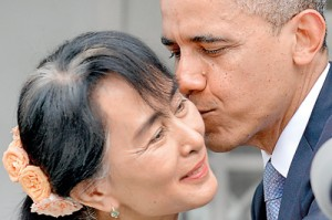 Obama kisses Myanmar opposition leader Aung San Suu Kyi after speaking to the press following their meeting at her residence in Yangon on November 19. AFP