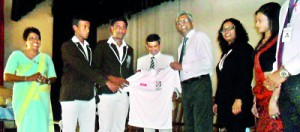 Radley Stephens Country Director CIMA handing over cricket kits to Jayanga Nirmana de Silva captain of STC Matara in the presence of principal W B Piyatissa.