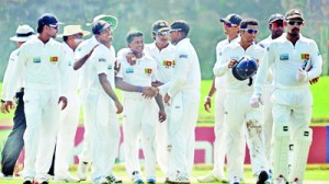 The Lankan players flocking round leg spinner  Rangana Herath after he limited the New Zealand second innings to a mere 118 runs with a match bag of 11 for  108  and made sure of a comfortable  win. (Pic by Amila Gamage)