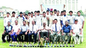 The victorious Gateway U-17 cricket team with their chairman, R.I T Alles and other officials.