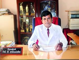 The Principal  S.P.Ariyarathne