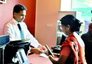 Mr. Rajiv Gunasena, Deputy Managing Director - M. D. Gunasena receiving the first transaction from Mrs. Sujatha Devendra – Vice Principal of Visakha Vidyala