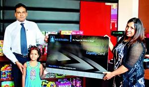 Mrs. Chayani Deen one of the longest standing customers receives the Loayalty Membership card from Mr. Rajiv Gunasena, Deputy Managing Director - M. D. Gunasena