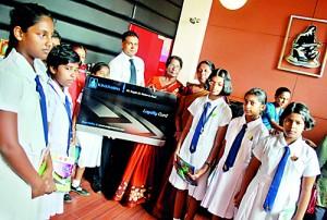 Mr. Rajiv Gunasena, Deputy Managing Director - M. D. Gunasena hands over the Loyalty Membership to Mrs. Sujatha Devendra – Vice Principal and students of Visakha Vidyala the first school to receive the Loyalty Membership