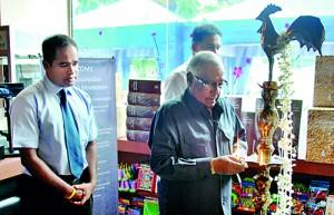 Mr. Percy Gunasena – Chairman M. D. Gunasena lighting the oil lamp.