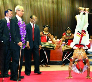 Retired civil servant Bradman Weerakoon looks on in amusement probably  wondering whether the country is also upside down like this dancer. The event was the annual Integrity Awards of Transparency International (TI) on Thursday in which Mr Weerakoon was the chief guest. Pic by Amila Gamage.