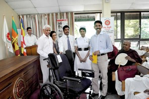 At the 7th Annual General Meeting of the Red Lotus Organisation held recently, ten wheel chairs and crutches donated by Wheel Chairs for Sri Lanka (WC4SL) in Canada were handed over to recipients. In the picture are Guest Speaker, Dr. Pushpa  Ramyani de Zoysa,  President  Deshabandu Olcott Gunasekera, Hony Secretary Dr. Hema Goonatilake, Director Planning, Ministry of Social Services and Hony. Secretary, M. Ramamoorthy and a representative of the Pahalamapitigama Rajamaha Vihara Welfare Society Ajith Nawagamuwa, receiving a wheel chair.