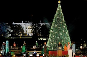 Festive greetings from the most powerful person: President Obama and his family are dwarfed by the enormous Christmas tree as he bids a 'Happy Christmas' to all in attendance at the 90th annual lighting of the National Christmas Tree on Capitol Hill