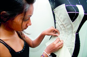 Above- Shanika, Final year Fashion Design student drapes a dress form.