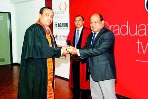 Dr. Amal Harsha Provincial Director of Health Western Province presenting awards