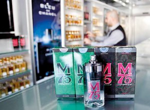 A vendor displays perfume bottles called M75 at his shop in Gaza City (Reuters)