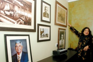 Mrs. Senanayake  points to  a family photo gallery