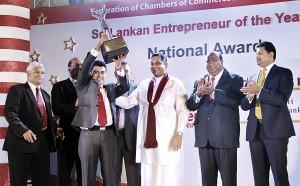 Seen here from left - Nalin Attyagalle (CEO) - FCCISL; Kumar Mallimaratchi s(President) -FCCISL; Nayana Dehigama (Platinum Winner 2012); Lal Keerthi Gunawardena (Platinum Winner 2011) and Managing Director Lucky Lanka (Pvt) Ltd; Shashindra Rajapaksha (Chief Minister)-Uva Province; Ajith Wattuhewa -(Senior Vice President) FCCISL nd W.K.H. Wegapitiya -(Vice President )FCCISL.