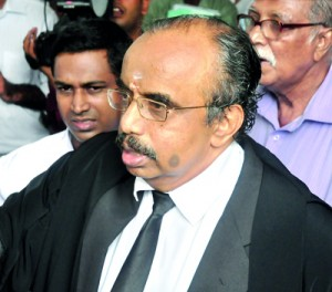 Chief Justice Bandaranayake's counsel K. Neelakandan explaining a point to journalists after the Court of Appeal on Jan 3 read out the Supreme Court ruling that the PSC has no legal validity to probe the impeachment motion against the CJ.