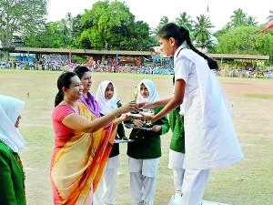 Chief Guest minister Pavithra Wanniarachchi distributing an award.
