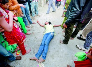 A devotee who is believed to be possessed by evil spirits falls on the ground at Guru Deoji Maharaj temple during a ghost fair at Malajpur village in Betul district in the central Indian state of Madhya Pradesh (REUTERS)
