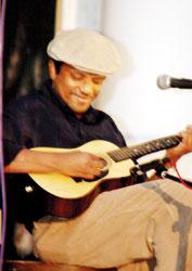 Feizal Samath: Strumming  his guitar for a cause