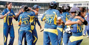 Sri Lankan women cricketers celebrate their win against defending world champions England in the ICC Women's World Cup 2013 played in Mumbai