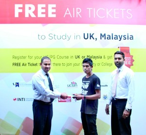 From Left Chairman of BCAS Mr. Abdul Rahman handing over the free Air to the Student along with Regional Manager Azaad Abdulla.