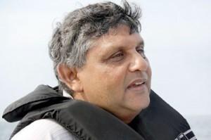 D.H.P.  Peramunagama,   Director at the Peradeniya Botanical Gardens is an avid dolphin watcher