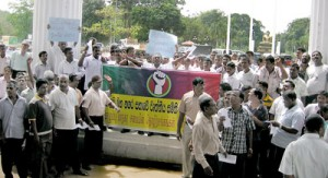 About 3,000 workers stage a protest outside the CMC premises on  Tuesday. Pic by Athula Devapriya