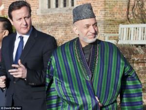Corruption concern: Afghan civil servants and officials pocketed �2.5bn in bribes last year despite promises by President Hamid Karzai (pictured with David Cameron) to clean up his government