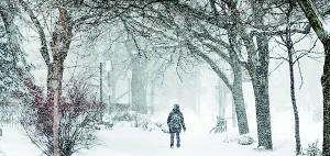 A woman walks through snow during the winter storm (Reuters)