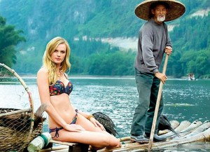 Bumpy ride: In its latest swimsuit issue, now on sale, Sports Illustrated featured a white, blonde model sitting on a raft in China operated by a man wearing a typical cone hat
