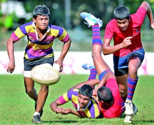 A tussle for the ball..... Two players from Prince of Wales' and Kingswood take off to win possession.  - Pic by Amila Gamage